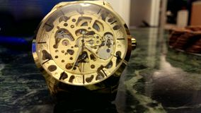The ticking golden wristwatch stock footage