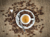Tickle healthy. Composition with aromatic coffee beans and coffee cup Stock Images