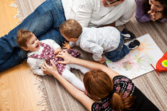 Tickling a babe girl family Stock Photography
