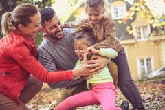 Tickling with family make me laugh. Little girl. Leisure activity Stock Image