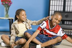 Tickling her brother royalty free stock photography