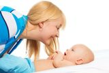 Tickling little baby Royalty Free Stock Images