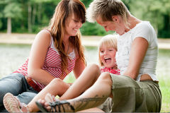 Tickling one of the girls Royalty Free Stock Photography
