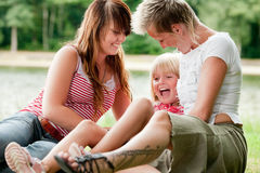 Tickling one of the girls Royalty Free Stock Photo