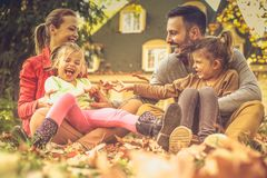 Tickling time is the really funny. Family spending time together in backyard. Autumn season stock images