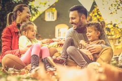 Tickling time is the really funny. Family spending time together in backyard. Autumn season stock photo