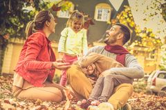 Tickling time is the really funny. Family spending time together in backyard. Autumn season royalty free stock photo