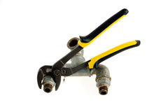 Ticks and taps. Yellow pliers and an old valve on a white background Stock Photography