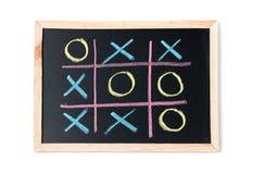Tictac teen op een zwart geïsoleerd bord Royalty-vrije Stock Foto's