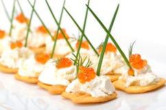 Tid bits avec le caviar Photos stock