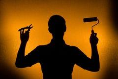 tid för silhouette för manrenoveringreparation Arkivbilder