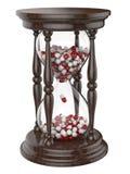Tid livtimglas med preventivpillerar Arkivbilder
