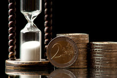 Tid och pengar arkivfoto