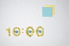 Tid och två klistermärkear Royaltyfri Foto