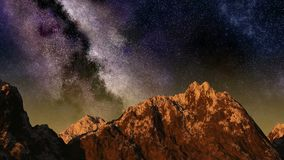 Time lapse of the sunset to night sky with stars passing by behind mountain Stock Footage