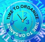 Tid som organiserar showledning, ordnar och organisationen Arkivbild