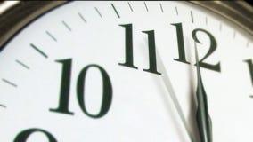 Tid tolv nolla-klocka lager videofilmer