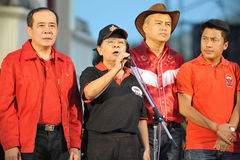 Tida Tawornseth Addresses a Red-Shirt Rally. Core red-shirt Leader Tida Tawornseth (C) addresses a large rally at Democracy Monument, held to mark the 6th Royalty Free Stock Photos