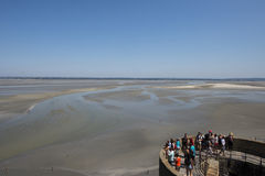 Tidal bay at Mont Saint Michel, France. Tidal bay seen from Mont Saint Michel ramparts. Le Mont-Saint-Michel is an island commune in Normandy, France. It is Stock Images