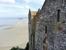 Tidal bay and wall of mont saint-michel abbey Stock Photos