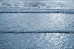 Tidal bore. Blue waves of the sea at sunrise Royalty Free Stock Photo