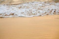 Tidal bore, sea foam. Tidal bore, sea bubble foam on sandy beach stock photo