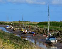 Tidal Creek at low tide. With boats moored,Saltfleet Haven,Lincolnshire Royalty Free Stock Image