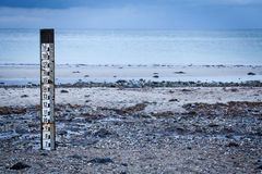 Tidal marker to measure the depth of the high tide Stock Photo