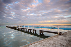 Tidal pool at sunrise. Long tidal pool board walk leading to an amazing ocean view royalty free stock photography