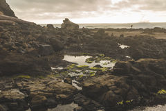 Tidal Pool Surrounded by Jagged Rock Royalty Free Stock Images