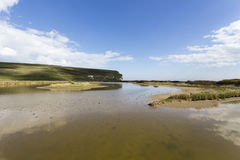 Tidal pools and the Seven Sisters Cliffs Royalty Free Stock Image