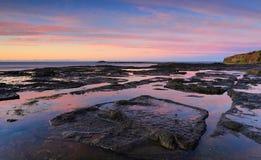 Tidal reflections beach coast Geroa Australia Royalty Free Stock Images