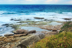 Tidal rocks Tamarama Royalty Free Stock Photography