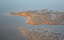 Tidal sand and sea water patterns Stock Photography