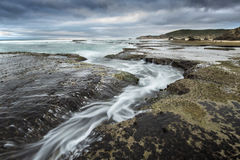 Tidal stream at Portsea Beach. Stock Photos