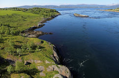 Tidal stream Saltstraumen near Bodø, Norway. Tidal stream and rocks on a very clear blue day Stock Photo