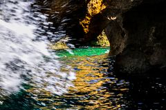 Tidal wave in the cave Stock Photo