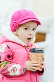 toddler girl with hot drink Royalty Free Stock Images