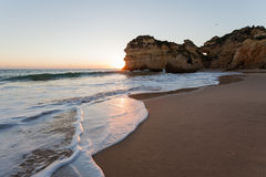 Beach at sunset. The tide coming in at sunset on a beach in Lagos, Portugal Stock Images