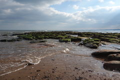 Tide covering Rock Pools Royalty Free Stock Image