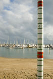 Tide gauge. A graduated pole for measuring high tides in a marina Royalty Free Stock Photography