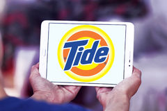 Tide laundry detergent logo. Logo of tide laundry detergent or washing powder on samsung tablet Stock Photos