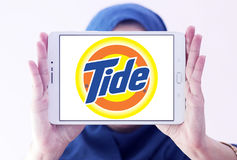 Tide laundry detergent logo. Logo of tide laundry detergent or washing powder on samsung tablet holded by arab muslim woman Stock Images