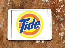 Tide laundry detergent logo. Logo of tide laundry detergent or washing powder on samsung tablet on wooden background Stock Photo