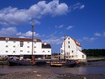 Tide Mill, Woodbridge, Suffolk. View of the tide mill and boats along the quayside, Woodbridge, Suffolk, England, Western Europe stock photo