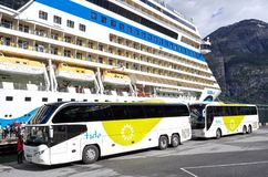 Coaches of tide ASA waiting at AIDAsol for shore excursion passengers. Tide is one of the largest coach companies in Norway royalty free stock image