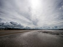 Tide out, storm coming in. Weston super Mare, Somerset, England. Photo September 2017. Weston is famous or it huge tidal range, on the English Channel Royalty Free Stock Photo