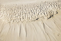 Tide pattern. Left by the movement of the surf Royalty Free Stock Photography