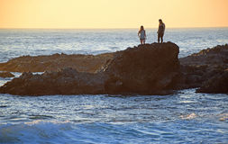 Tide pool exploring during sunset at Woods Cove Beach in Laguna Beach, California. Stock Photography