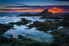 Tide pools at sunset, at Little Corona Beach, in Corona del Mar, California. royalty free stock photos